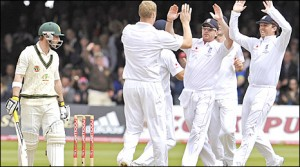 England congratulate Andrew Flintoff after his delivery saw Australian opener Hughes caught by Strauss.