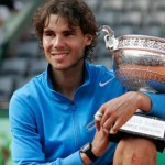 Rafael Nadal with the 2011 French Open Trophy