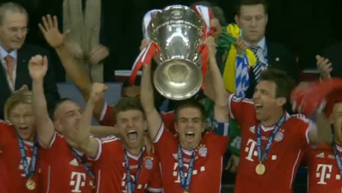 Bayern Munich captain, Philip Lahm, holds the UEFA Champions League trophy aloft after winning the tournamnet in 2013