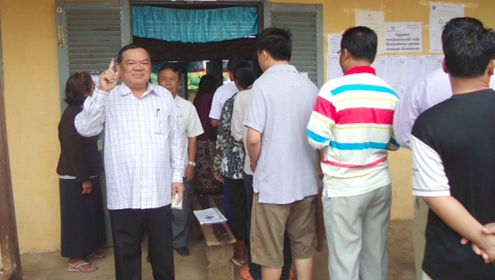 Members of the Cambodian Royalist party, FUNCINPEC vote in the election
