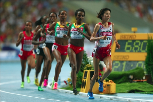 Hitomi Niiya of Japan leads the pack in the Women's 10000 final during Day Two of the 14th IAAF World Athletics Championships Moscow 2013 at Luzhniki Stadium on August 11, 2013 in Moscow, Russia. (Photo by Getty Images/Getty Images for SEIKO)