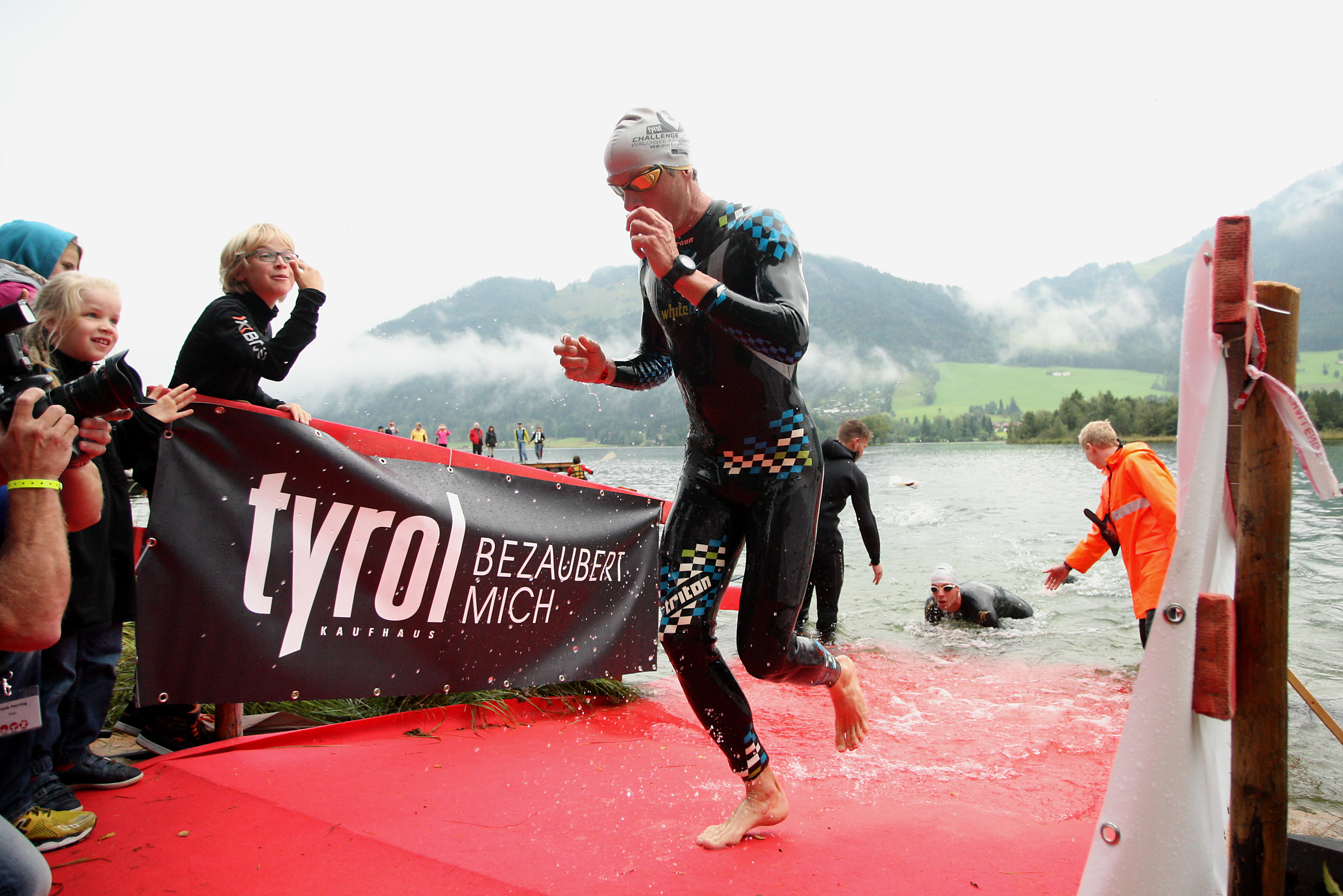 A competitor exits the water during the Challenge Triathlon Walchsee-Kaiserwinkl on September 1, 2013 in Walchsee, Austria. (Photo by Stephen Pond/Getty Images for Challenge Triathlon)