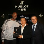 Kobe Bryant and CEO of Hublot, Ricardo Guadalupe, present a lucky customer with the first Hublot Black Mamba Watch in China