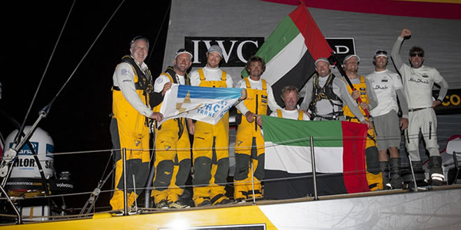 England, Cowes, 15th August 2014. Sevenstar Round Britain and Ireland Race. Abu Dhabi Ocean Racing crew celebrates crossing the finish line off Royal Yacht Squadron, Cowes at 22.20.28 BST on Friday 15th August 2014 with an elapsed time of 4 days, 13 hours, 10 minutes, 28 seconds. This breaks the previous World Record and Race Record for a monohull set by Volvo 70 Groupama in 2010.(c) Ian Roman / Abu Dhabi Ocean Racing
