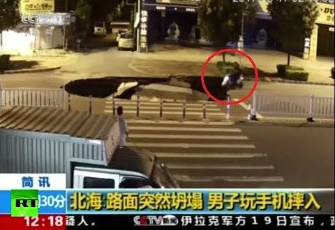 RAW: Motorcyclist plunges into sinkhole in China while fiddling with his phone